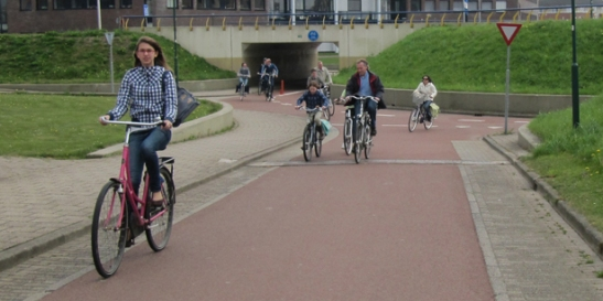 Cyclists in Houten. The safety for cyclists increases every year in the Netherlands.