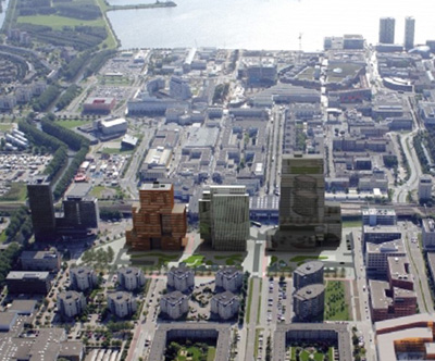"""Almere city centre, not your typical Dutch city. From right to left just behind the tall buildings you can see the elevated cycle path """"Spoorbaanpad"""" next to the also elevated railway."""