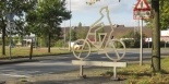 The -upright- cyclist icon at a junction in the Breda - Etten-Leur cycle highway.