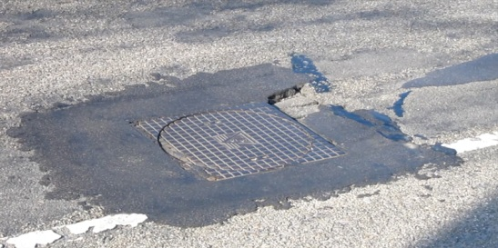 Before: earlier repairs clearly visible and an uneven surface.