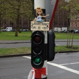Barbie doll on top of traffic light