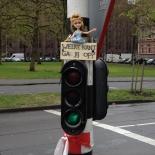 Barbie doll on top of traffic light