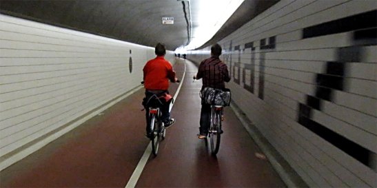 Inside Benelux Cycling Tunnel. To the right a fragment of the poem.
