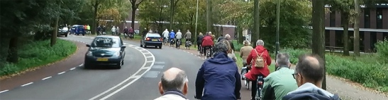Elderly people cycling