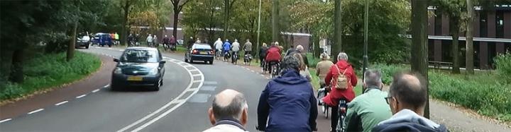 Elderly people cycling