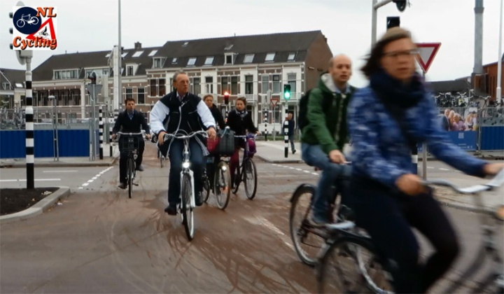 People cycling are grouped together because of traffic lights in other locations.