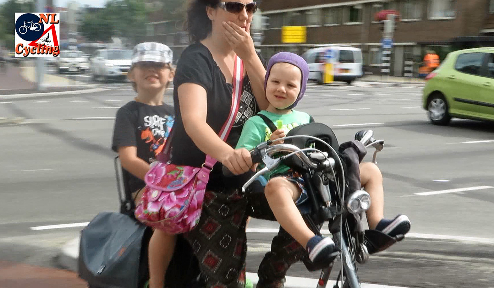 Baby chair on bike - This Mother Rides With Her Two Children The One In The Front Is Getting A Bit Big For The Seat A New Solution To Transport These Two Will Have To Be Found