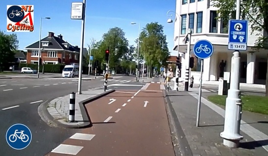 A dedicated left-turning lane in the cycleways. So a number of people can stand there to wait for the light without being in the way of people wanting to straight-on.