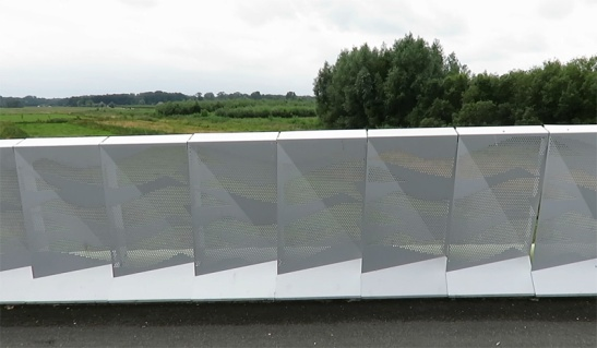 The sides of the bridge are aluminium sheets perforated in a bird pattern.