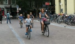 This woman cycles safely with three young boys in the reconstructed Mariaplaats.