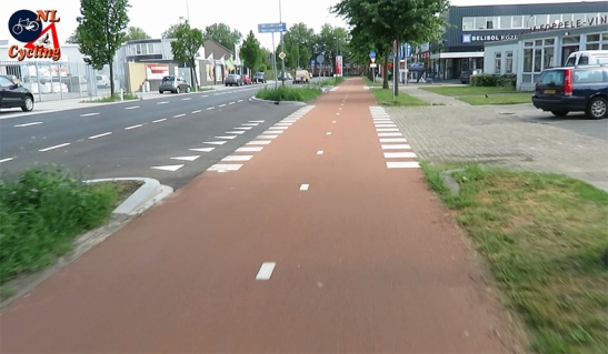 A commercial driveway crossing. There is virually no difference between this and a side street crossing.