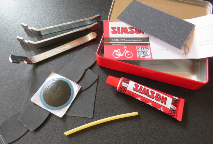 Tire levers, patches, a piece of sand paper and vulcanising glue.