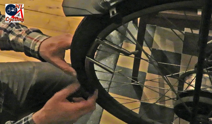 The tire levers placed between the tire and the rim, to lift the bead of the tire over that rim.