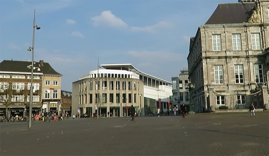 Maastricht, Mark in 2016. The square is car-free. The brutalist 1960s buildings have been demolished and replaced by a more fitting building. The street (a break through for traffic) has become a block of buildings again.