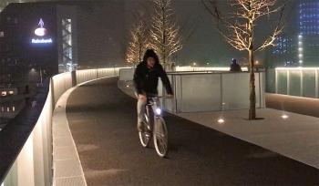 The bridge is beautifully lit at night.