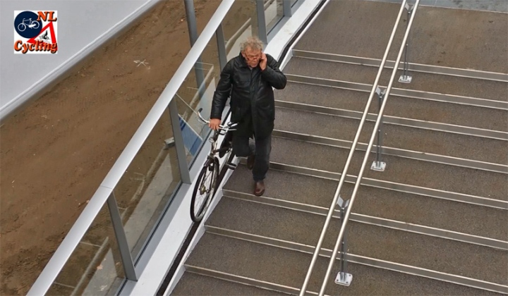 People have little trouble with the stairs. This elderly gentelman doesn't even stop talking on his phone while descending the bridge with his bicycle.